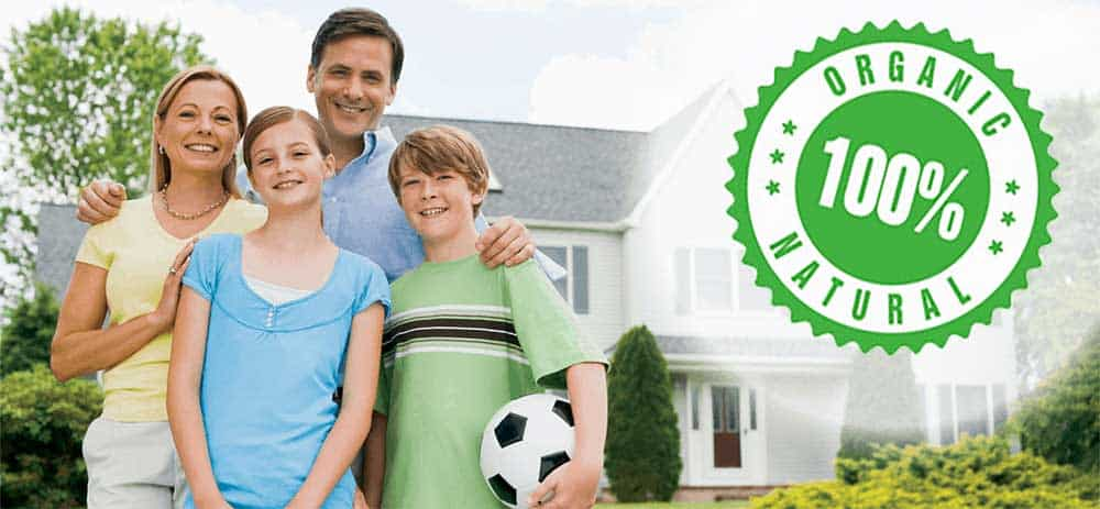 family in front of house, 100% organic pest control